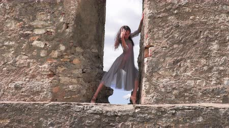 pirouette : Ballerina dancing in the window of an old castle Stock Footage