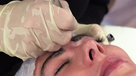 eyebrow correction : microblading procedures in a beauty salon Stock Footage