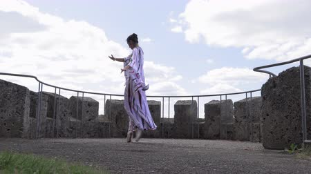 tüt : Ballerina dancing on the stage of the old castle Stok Video
