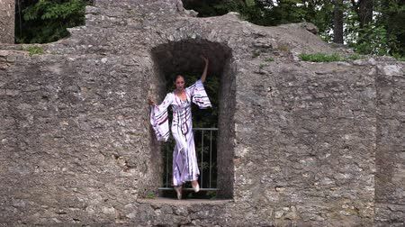 tüt : Ballerina dancing in nature near the ruins of an ancient castle