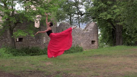 balerin : Ballerina dancing near the ruins of an old castle