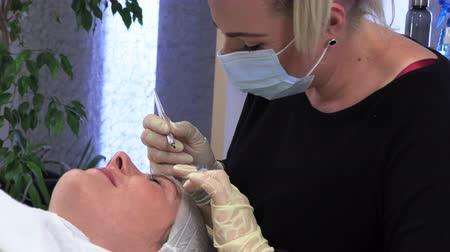 microblading : Young girl doing microblading procedure