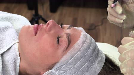microblading : Young girl make permanent makeup. Eyebrow Microblading