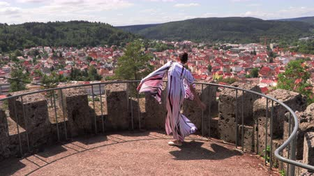 tiptoe : Ballerina dancing on the street on the ruins of an ancient castle Stock Footage