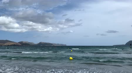 seafront with surfers on the island of Mallorca Wideo