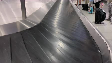 baggage conveyor belt at the airport with suitcases