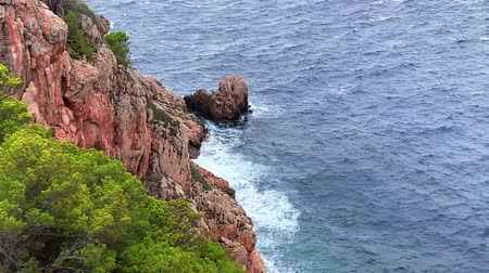masso : in Mallorca a blue bay with a rocky coast