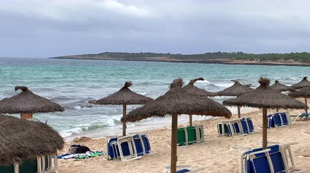 parasol : beach umbrellas on the coast of Mallorca Wideo