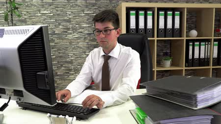 computer programmer : tired accountant does not readily sort documents Stock Footage