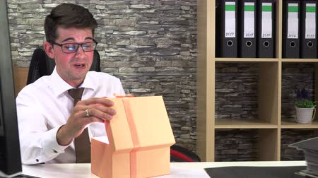 accountant received a gift and rejoicing opens it at the workplace