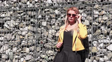 yellow jacket : Beautiful blonde in a yellow jacket and sunglasses