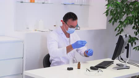 pathology : young male lab worker in the workplace
