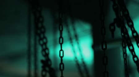 mroczne : A lot of chins in the location. Room full of chains. Chains in dark space