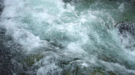 fresh water : SLOW MOTION: surface boiling water Stock Footage