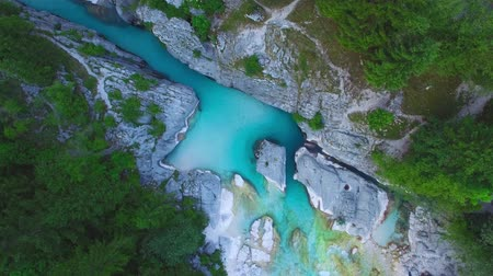 AERIAL top down view: flight over mountain river Soca. Camera rotates