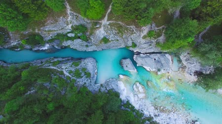 AERIAL top down view: flight over mountain river Soca. Camera moves from top to down