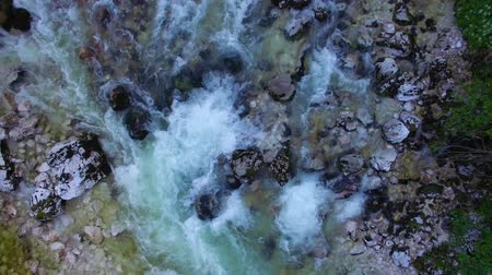 AERIAL vertical view: flight over the surface of a mountain river