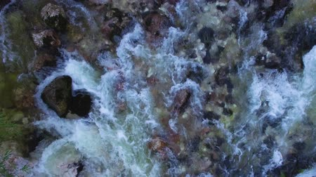 крайняя местности : AERIAL vertical view: flight over the surface of a mountain river