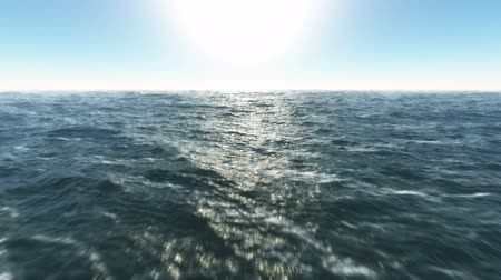 horizonte sobre a água : Ocean fly over,HD high speed animation just above the ocean waves facing the sun .