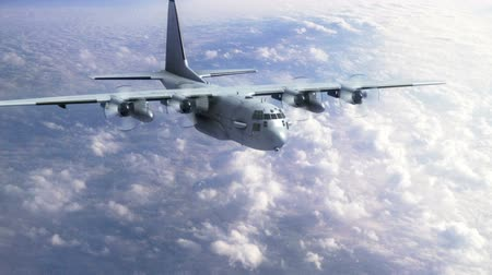 letadlo : Ac 130 Gunship flying into view from high above the clouds
