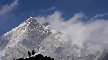 nuptse : Hikers at mount Nuptse, Himalaya. Timelapse