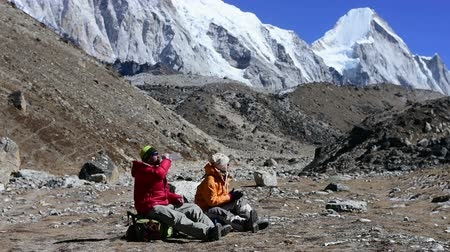 nuptse : Trekkers resting at Khumbu glacier High Himalaya mountain, Nepal Stock Footage
