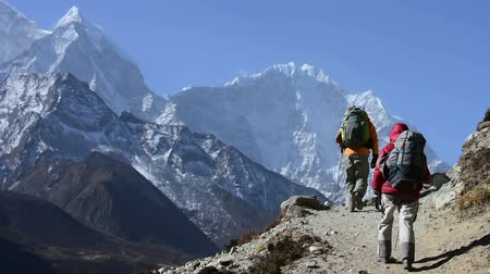 nuptse : Trekkers hiking at High Himalaya mountain