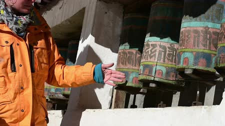 bhutan : Trekker Spinning prayer wheels at Namche bazar.