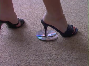 compact disc : Woman Angrily Stomps and Smashes a CD in her Sexy High Heels on office floor