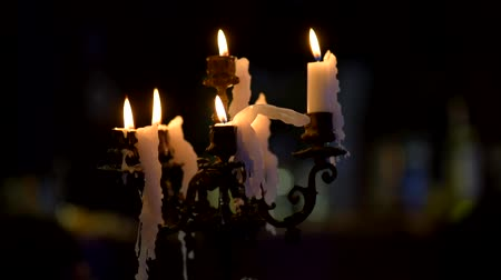 titular : Burning candles on old vintage candlestick on dark background Stock Footage