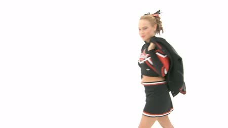 гибкость : Cheerleader throws jacket over her shoulder and leaves the screen