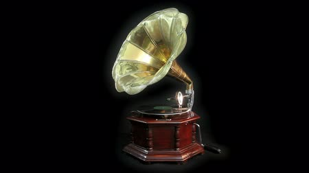 agulha : Vintage Gramophone playing a record with black background