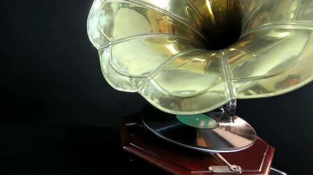 gravar : Vintage Gramophone playing a record with black background
