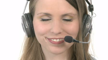 fejhallgató : Callcenter Agent puts her headphones on and smiles