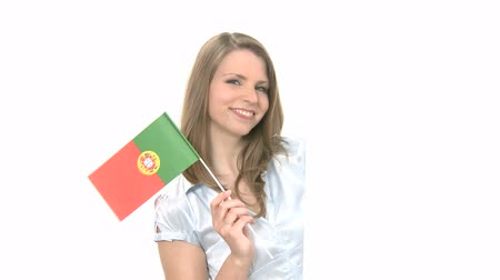 portugalsko : Attractive woman shows and waves flag of Portugal with copyspace. Background is highkey, therefore object can be moved or scaled for different size of copyspace. Dostupné videozáznamy