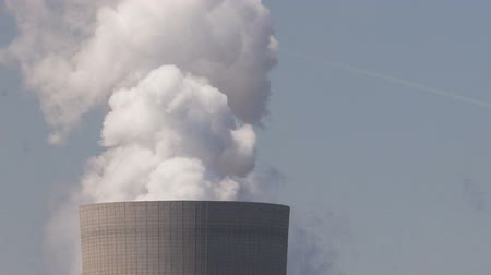 powerplant : Timelapse of brown coal power plant with huge cooling towers and steam and powerlines