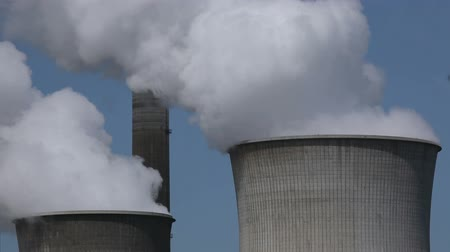 climate : Brown coal power plant with huge cooling towers and steam Stock Footage