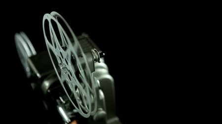 projetor : Film reel of an 8mm vintage Projector and black background