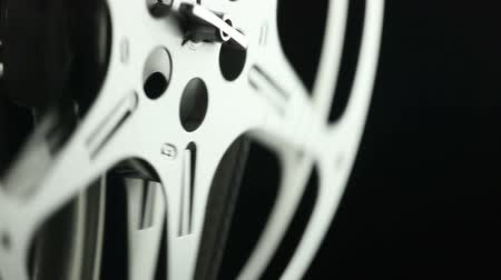 kino : Film reel of an 8mm vintage Projector and black background