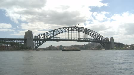 area of port : Sydney Harbor Bridge at daytime with ships in the Harbor Bay Area Stock Footage