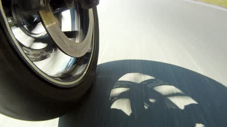 motocykl : Motorcycle Wheel Close-up racing on the highway