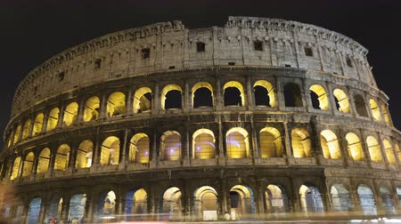 colloseum : 4K Time lapse zoom out of traffic in front of the majestic colosseum Amphitheater, Rome, Italy. Stock Footage