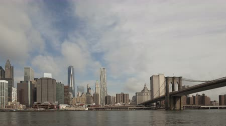 new world : 4K Time lapse zoom in Manhattan skyline with World Trade Center at waterfront and Brooklyn Bridge, New York