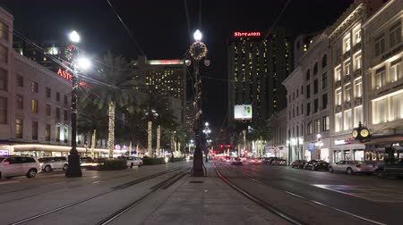 new car : NEW ORLEANS, USA - DEC 9, 2011: 4K Time lapse tilt shot moving down of New Orleans Canal Street with streetcars and traffic in downtown New Orleans at night