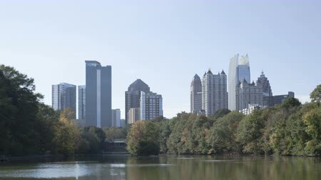 ga : 4K Time lapse close up Skyline of downtown Atlanta, Georgia from Piedmont Park Stock Footage