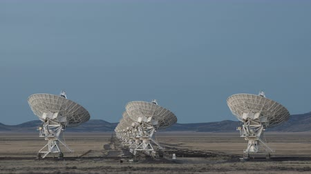 radio wave : 4K Time lapse Very Large Array Radio Telescopes dish alignment at twilight in New Mexico, USA