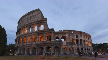 colloseum : 4K Time lapse zoom out of tourists visiting the colosseum Amphitheater in Rome, Italy during twilight and sunset.
