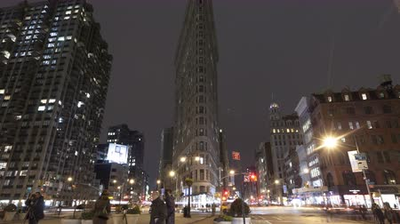 nyc : NEW YORK CITY, USA - MAR 13, 2014: 4K Time lapse zoom out of traffic at night at the crossing next to Flatiron Building in New York at 5th Avenue with Taxis rushing by. Stock Footage
