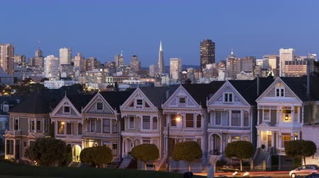 san francisco : 4K Time lapse sunset close up of the Painted Ladies in San Francisco with the skyline in the background During twilight