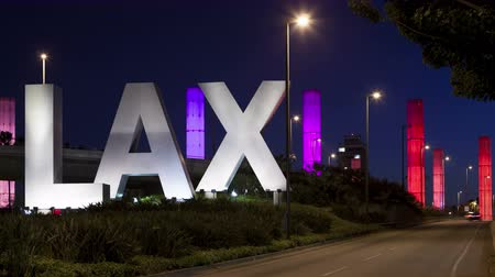 light trails : LOS ANGELES CA USA  APR 15 2015: 4K Time lapse of LAX Sign at Los Angeles airport at twilight with traffic light trails